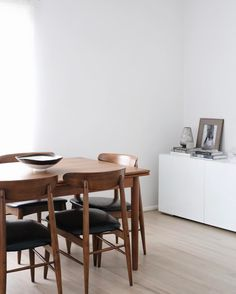 minimalist dining room with midcentury danish table and chairs