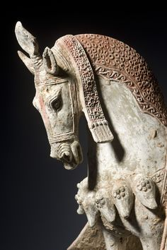 A& J Speelman Oriental Art | Chinese | Early Ceramics | A painted grey pottery figure of a caparisoned horse