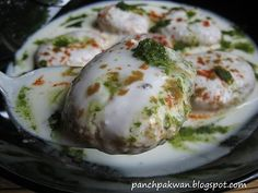 Moong Dal Dahi Vada Ingredient: 2/3 cup Moong dal  1/4 cup Urad dal 1 tsp Cumin seeds 1/4 tsp Ajwain 1/2tsp Ginger paste 2-3 green Chilies (finely chopped) A pinch of Hing 1/4 tsp Baking soda Salt and Black pepper as per taste. Oil for deep frying 1-2 cup Yogurt 1-2 tsp Sugar (optional) Few pinch of Cumin & red chili  powder.