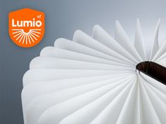 Lumio: A Modern Lamp With Infinite Possibilities by Max Gunawan, via Kickstarter.  A lamp that looks like a book; it's off when closed, and turns on when the cover is opened.