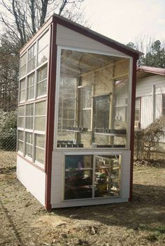 I don't have this many old windows to use in my shed but this does give me ideas. The owner has water barrels inside to dispurse heat gain at night.