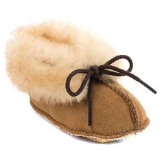 Minnetonka Tan Sheepskin Bootie size 3 Worn once. Like new condition! Thick sheepskin fluff ensures a cozy foot for your little gal, while the Minnetonka Kid's Sheepskin Bootie's cushioned footbed delivers soft, lasting padding. Cushioned footbed Decorative lacing Sheepskin trim and lining Slip-on entry Stitching details Suede outsole Suede upper Style Number: 1462 Minnetonka Shoes Baby & Walker