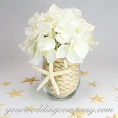 Beach Centerpiece - Natural Sisal Rope (3/8-inch) placed inside a glass vase.  http://www.yourweddingcompany.com