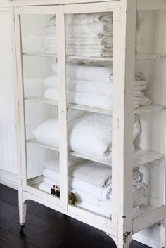 Display beautiful linen in an old medical cabinet