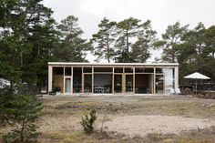This summer house by Imberg Arkitekter in a former garage on the island of Gotland is one of my favourites using simple materials like concrete and plywood. Exterior Design, Interior And Exterior, Beddinge, Converted Garage, Old Garage, Garage Doors, Glass Facades, Architectural Features, Scandinavian Home