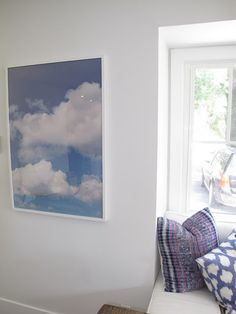 Amber from Amber Interiors took a photo of clouds, blew it up, and framed it in an IKEA frame.  I need to do this with some of my nature pics.