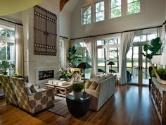 Great Room: Thanks to expansive 12-foot ceilings — the great room provides a front-row seat to Kiawah Island's dramatic marsh views. Glass doors offer a seamless transition from indoor to outdoor spaces. http://www.hgtv.com/dream-home/hgtv-dream-home-2013-great-room-pictures/pictures/index.html?soc=dhpp