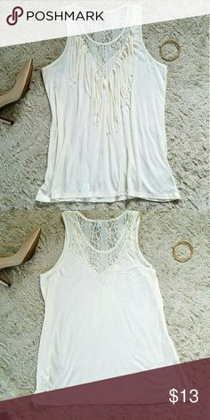 ?? Cream Color top w/ Lace?? This top has lace in the top and on the top back. The color is an off white. Does fit true to size. There's no pullings, tears, stains, or marks. Tops Camisoles