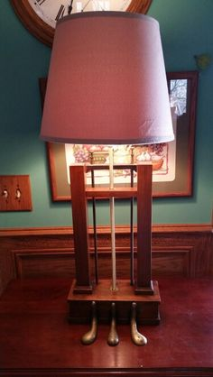 A lamp made from the pedals of a grand piano.
