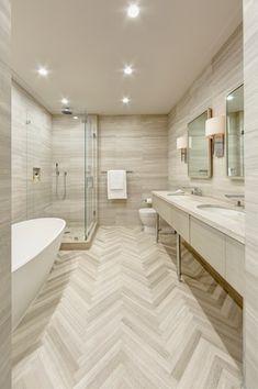 Contemporary Master Bathroom with frameless showerdoor, Freestanding, Handheld showerhead, herringbone tile floors, Flush