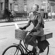 """Maggie Smith pedals about in Edinburgh during the filming of """"The Prime of Miss Jean Brodie"""" (1969)"""
