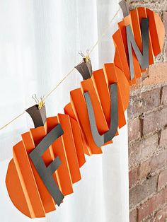 DIY Pumpkin Garland Banner {hand in front window and/or deck without letters}