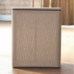 Caprina Upright Hamper by LaMont. $59.99. 4510118 Color: Champagne Features: -Caprina collection. -Constructed of 75% PVC and 25% polyester. -Material and construction make this a very durable item. -PVC/Polyester fabric makes this hamper stylish and functional. -Wipes clean with a damp cloth. -Made in USA.