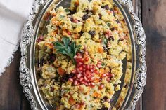 Pomegranate Cornbread Stuffing Recipe Side Dishes with cornbread, butter, olive oil, onion, dried apricot, dried cherry, chopped celery, pomegranate seeds, flat leaf parsley, large eggs, chicken broth