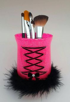 Glass Make up holder. (Makeup brushes not included) Corset and bow made with black vinyl. Clear rhinestones on each end of corset ribbon and silver rhinestone in middle of bow. Makeup Jars, Diy Makeup Brush, Make Makeup, Pink Makeup, Glitter Makeup, Makeup Tools, Girls Makeup, Blonde Makeup, Makeup Desk