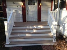 This Trex front porch creates an elegant entrance for this home with is wide staircase and white trim under the deck. This porch has the lock 1900 turn of the century home. Trex Composite Decking, Decking Material, White Trim, Front Porch, Entrance, Mario, Stairs, Elegant, Home