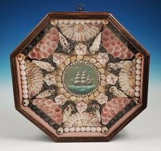 Woodman was a self-taught designer and craftsman of contemporary Sailors' Valentines based in Marstons Mills, Massachusetts. He created intricate designs using natural sea shells that were never colored or shellacked.