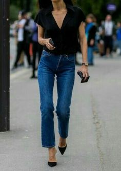 Simple black shirt and jeans for basic pieces of a casual capsule wardrobe.