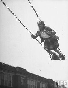 Suzy Creech swinging in the playground. Ohio, 1946. By Frank Scherschel. S)