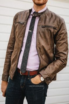 Shop this look on Lookastic: http://lookastic.com/men/looks/jeans-belt-bomber-jacket-tie-longsleeve-shirt/7161 — Black Jeans — Brown Leather Belt — Brown Leather Bomber Jacket — Charcoal Tie — Light Violet Long Sleeve Shirt
