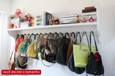 Handbag storage on wall-mounted rack.