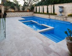 Travertine #PoolPavers and #PoolCoping. Unfilled travertine pool area. See these travertine pavers and more at http://www.stone-pavers.com.au/pool-coping-pool-pavers-tiles/