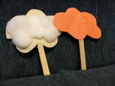 Pillar of cloud and fire, using Popsicle sticks to create these pillars. Use construction paper to make the cloud and fire. You can glue cotton balls to the cloud or red glitter to the fire to add effects.