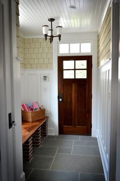 I like this entry with the mix of paint and stain, slate tile, beadboard ceiling...thinking this can be the inspiration for our side entry off the porch.