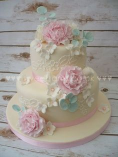 Two tier pink peony and ivory lace wedding cake