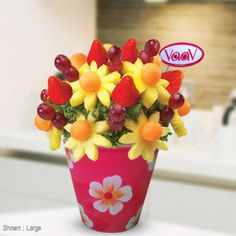 """This edible fruit arrangement is brimming with delicious strawberries, pineapples, grapes and cantaloupes.  <br>  <img src=""""http://www.vaav.ca/wp-content/select_add.png"""">"""