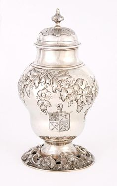 "1763 Covered vase at the Museums Sheffield, Sheffield -From the curators' comments: ""This Sterling silver container may have been used to hold condiments such as mustard powder or pepper....At this time a formal dinner usually consisted of two large courses that included many different small dishes....The table would have been too full to accommodate extra condiments and so they would have been kept on the sideboard and handed to diners by the servants."""