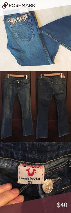 True Religion | Low-rise flare jeans These on-trend low-rise flares feature the signature TR pockets and contrast stitching. In very good condition--there is some wear to the bottom hem (see photo 3) but otherwise no signs of wear. No trades or PayPal. True Religion Jeans Flare & Wide Leg
