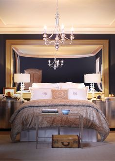 oversized mirrors make little bedrooms seem bigger...love this