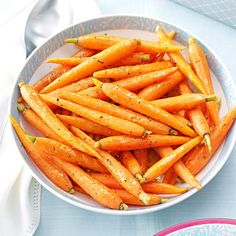 Sauteed Orange-Glazed Baby Carrots Recipe -Here's a wonderful accompaniment to just about any main dish, whether for a holiday or not. The carrots are sauteed in a sweet orange butter sauce with a unique blend of spices. —Angela Bartow, Cato, Wisconsin