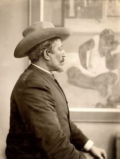 """Paul Gauguin in front of his painting """"Te Faaturuma"""" at his 1893 Durand-Ruel exhibition"""