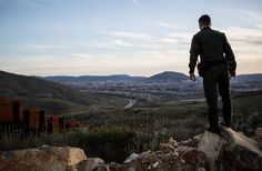 Jacopo Bruni, a Border Patrol agent, monitoring the border fence near San Diego. - Kirsten Luce for The New York Times