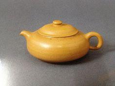 Small yellow clay tea pot