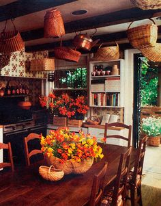 """This """"city kitchen with a country personality,"""" with its rustic beams, hand-painted tiles, bevy of baskets, and French provincial table and chairs, took top honors as the House Beautiful Kitchen of the Month in September 1981."""