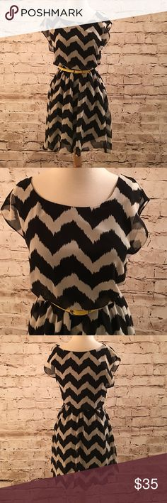 """Black and White Chevron Dress w Pop of Yellow NWOT In perfect shape and never worn. This dress is a chevron pattern silky sheer and flowing with a black slip liner underneath to prevent being see-through. No stains, snags or tears. Measures 18"""" from waist to bottom hem. Comes with yellow belt. Iz Byer Dresses Midi"""