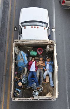 #SleepingCarpoolers - #AlejandroCartagena likes to take picture from a bridge above a highway oh north Mexico. Hi takes pictures of workers sleeping in their pickups' truck.