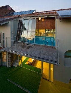 pool half inside half outside... plus those awesome sliding glass doors/windows