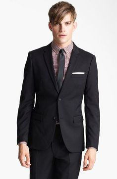 black white red gingham under charcoal suit.