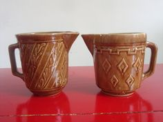 Pair of Brown Pottery Pitchers Made In USA.