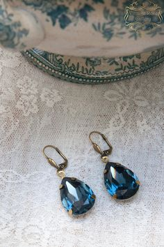 CHRISTMAS SALE, Blue Crystal Earrings , Vintage style earrings, Navy Blue Crystal Earrings, Boho Chic Earrings A gorgeous Navy Blue Teardrop pair of Crystal earrings . Features beautiful Navy Blue oval large crystals into antique bronze brass settings . With antique bronze lever