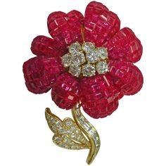 1970s Invisible Set Ruby Diamond Gold Brooch 29.71 Cts. T/W | From a unique collection of vintage brooches at https://www.1stdibs.com/jewelry/brooches/brooches/