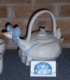 Mother Goose Tea set. Each cup has a hand painted nursery rhyme.