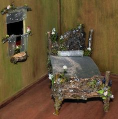 Gorgeous fairy bed and window ... I love the bark on the headboard and footboard - nice solid look, and pretty flowers decorate ... the windowsill as a 1/2 slice is really cute too - she does wonderful work!......love it....