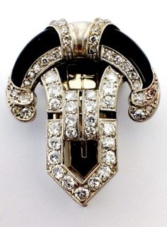 Robert Koch - An Art Deco gold, platinum, diamond and onyx clip, Frankfurt M und Baden Baden, circa 1925. #RobertKoch #ArtDeco #clip