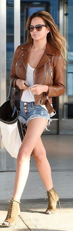 Who made Chrissy Teigen's brown leather jacket, denim shorts, sunglasses, green suede lace up boots, and brown leather jacket? Jacket – Acne  Shoes – Balenciaga  Purse – Givenchy  shorts – One Teaspoon  Sunglasses – Chloe