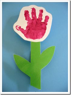 Great idea for Mother's day. Hand print flower mounted on a clothes pin w/ magnet. Great for my 2 year old class!